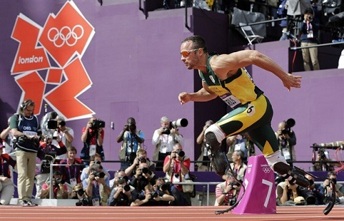 "South African athlete becomes 1st amputee to compete in Olympics ""Blade Runner"" Oscar Pistorius of South Africa became the first amputee to compete on the track at an Olympics, running in a men's 400-meter heat. The 25-year-old runner was born without fibulas and his legs were amputated below the knee before he was a year old. He runs on carbon-fiber blades. Read more from AP.Photo: Oscar Pistorius starts in a men's 400-meter heat at the 2012 Summer Olympics. (David J. Phillip/Associated Press)"