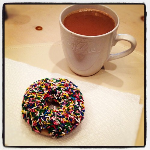 Breakfast of champions. #KrispyKreme #coffee #vacation #fatgirlproblems #foodporn #sprinkles #south #instadaily #instahub (Taken with Instagram)