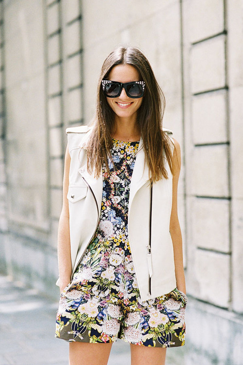 Pair your favorite summer romper with a vest to transition into fall
