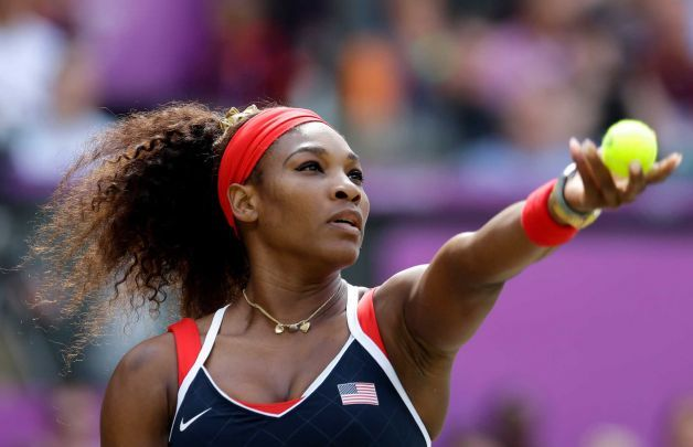 United States' Serena Williams serves to Maria Sharapova of Russia in the women's singles gold medal match at the All England Lawn Tennis Club at Wimbledon, in London, at the 2012 Summer Olympics, Saturday, Aug. 4, 2012. Photo: Elise Amendola / AP Serena Williams beats Sharapova for Olympic gold