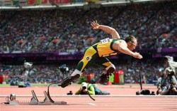 "Ready, set, go: Oscar Pistorius makes history in 400m heats Photo: AFP  Oscar Pistorius second in 400m heats as he becomes first double amputee to compete in the Olympics Oscar Pistorius has broken new ground with every stride of his carbon-fibre blades, but the most precious steps of all were the ones that took him into the London Olympic Stadium on Saturday morning.  The South African has collected four Paralympic gold medals and a world championship silver medal in an inspirational career, but the title that mattered most was that of Olympian.   On Saturday morning, at 10.31am, he earned the right to use it. Pistorius appeared in the first heat of the 400m and qualified for Sunday night's semi-final, which is the limit of his ambition in London, but he has already redefined the notion of ""taking part"".   Emerging onto the track under the cover of Jessica Ennis's appearance in the long jump, he bounced onto the track and joined his competitors   for the start of the opening heat of the men's 400m.   It took a moment for the crowd to notice that the man in lane six was different to his rivals. Only when he essayed a start and sprung from his blocks to jog the first bend did the penny drop that the 'blade runner' was in the building."