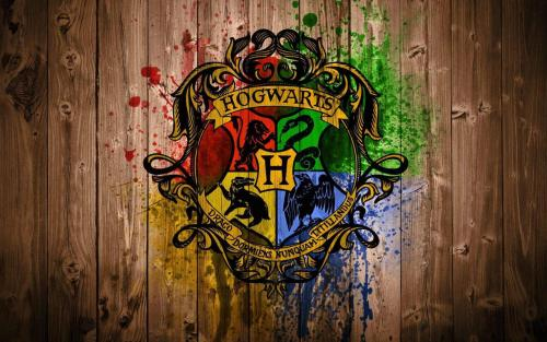 harry-potter-overdose:  My hogwarts wallpaper (shield on wood)Click for the best harrypotter tumblr ever.