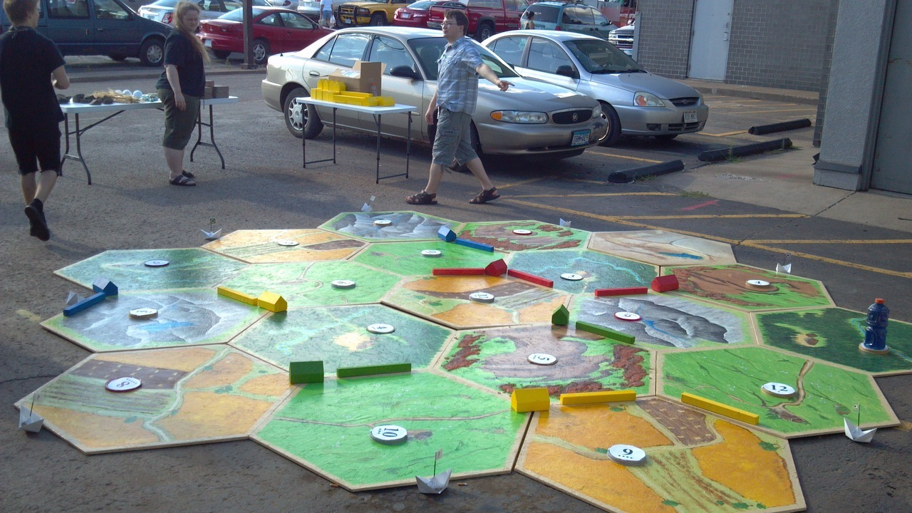 "dungeonsend:  Catan, life sized. It was a push to the finish but we got it done, with a little help from a couple of our customers (thanks Logan and Sean!)  Then we set it up in the parking lot and had ourselves a game.   This is our FLGS, Dungeon's End! I only managed to make 5 sheep for their game. They need more, but next year they'll have all their sheep plus maybe a robber. They did an AMAZING job on this board. This was done for a local event in Duluth called ""Spirit Valley Days""."