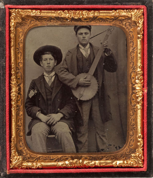 tuesday-johnson:  ca. 1860's, [tintype portrait of two gentlemen, one playing the banjo] via Heritage Auctions