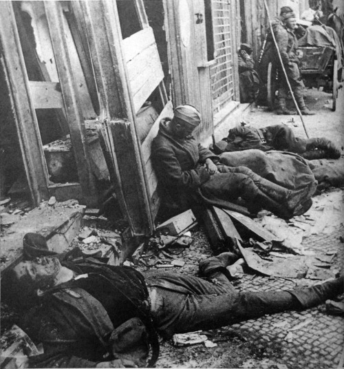 collective-history:  Soviet soldiers resting between fighting in Berlin amidst dead German soldiers, Berlin, Germany, by Ivan Shagin 1945