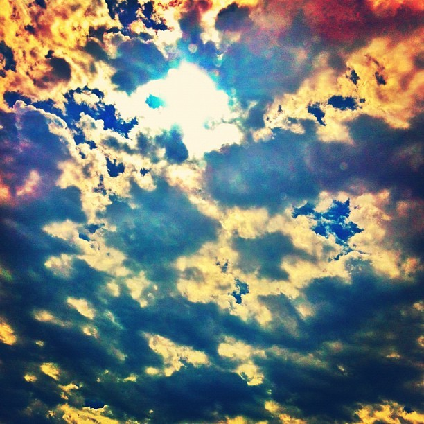 #sun peeking through the #clouds. #sky #skyporn #cloudporn #igers #instagood #iphonegraphy #picoftheday #photooftheday (Taken with Instagram)