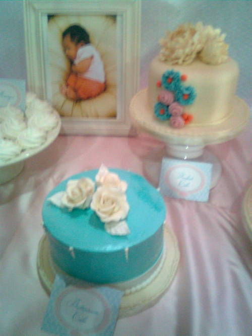 The cake during my niece's baptismal party. That's her cuddled up into a ball in the photo. This cake is super yummy!