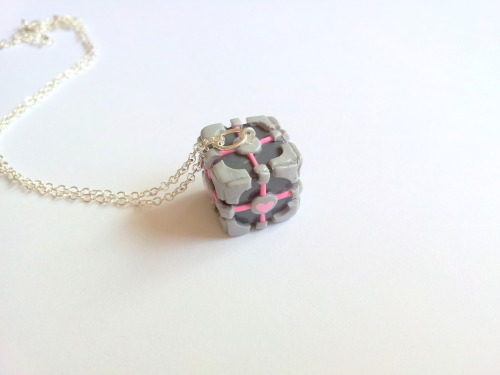 (via Weighted Companion Cube necklace by geeniejay on Etsy)