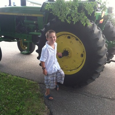 Luke by the wedding tractor (Taken with Instagram)