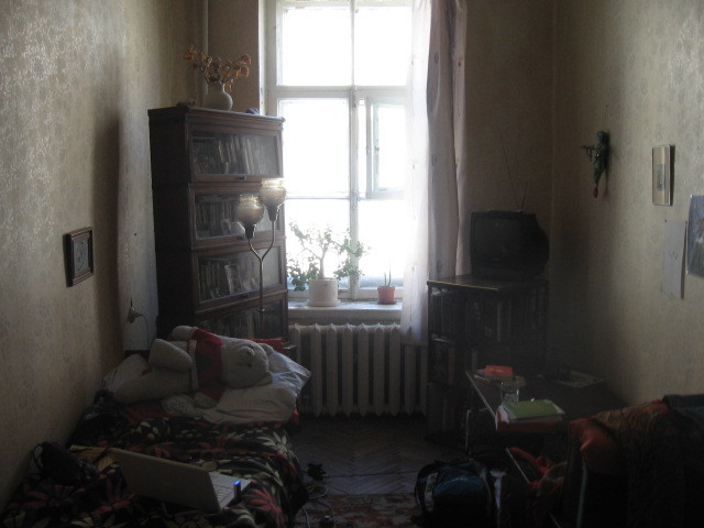 I spent 2011 studying abroad, living with a host babushka in Saint Petersburg, Russia. I thought it would be cool to also submit this teenage bedroom- the room I stayed in was my host Galina's daughter's room from when she lived there in the 80s and 90s. So, a soviet/post soviet teenage bedroom! All the stuff in it was wicked cool.. she had the Russian versions of lots of excellent disney movies as well as tiny, gilded leather books of poetry. And so many diaries and sketches and photos from her friends! As you can see, I brought Aloysius, my faithful bear/pillow whom I've had since I was 5.—darlingdaintyfoot This is amazing! Thank you so much for sending it in!
