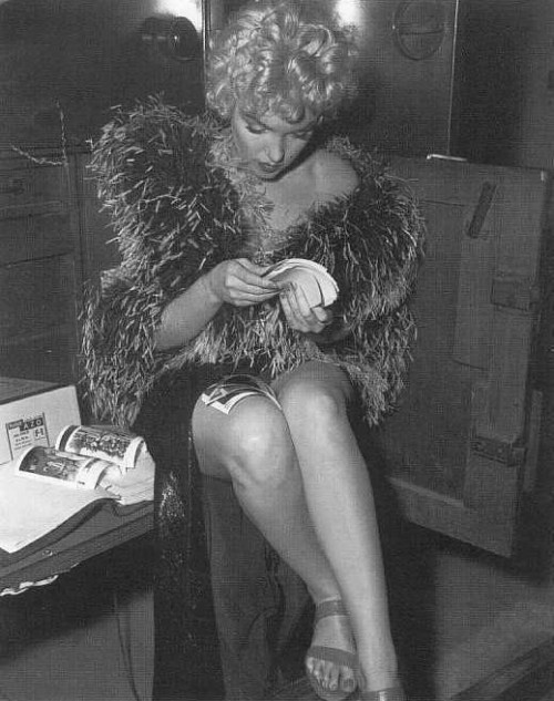 "#Marilynettes ~ Marilyn Monroe looking through photos of herself on set of ""The Seven Year Itch."" [1954]"