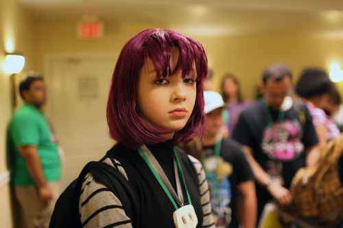 Zoetica Ebb sent me some of the photos she took at InvaderCon recently, and this one really stood out.  One of my favorite things at conventions, the only thing really that brings me any joy anymore at them is the sight of people dressed up whimsically but looking miserable.  In this case, it couldn't be any more appropriate than someone cosplaying as Gaz.  Everything about her costume is great, and the fact that she looks genuinely unhappy only makes it more perfect.  Well done, gloomy little Gaz girl!