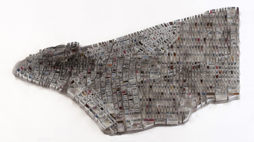 "Paper Cities by Matthew Picton Mathew Picton creates detailed aerial viewed sculpture maps of numerous famous cities. What's interesting to note is that he uses various books, film stills, or news paper articles to represent a specific moment that defined the city which he is creating. The two pieces seen above are of Lower Manhattan and Venice. Lower Manhattan is created from headlines that accompanied the 2001 World Trade Center disaster and DVD covers of the film ""Towering Inferno"" also book covers of the novel ""The Plot Against America"" by Philip Roth. Venice city is created out of text from ""Death in Venice"" by Thomas Mann, and sheet music from Benjamin Britten's ""Death in Venice Opera"".   Artists: 