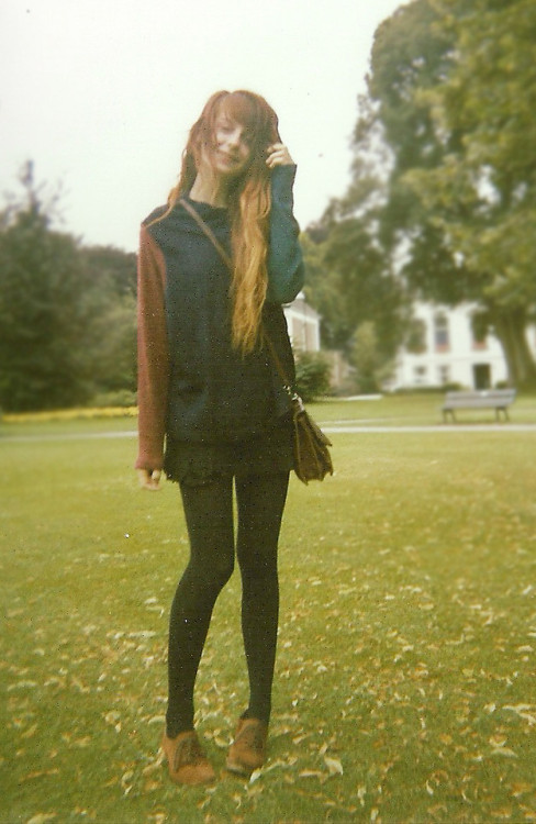 Disposable camera and great sweater (by Nadia Esra)