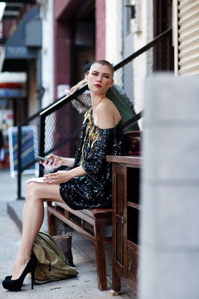st-rita:  On the Street… 18th St., New York via The Sartorialist Hands-down, my favorite street style photo: the shaved head, strong eyebrows, dark lipstick, over-the-top dress + heels (and not a speck of jewelry or nail polish) juxtaposed with the grungy backpack + change of shoes. So cool!
