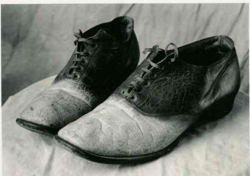 criminalwisdom:  Shoes Made From Human Skin  Towards the end of the 1800s, many outlaws emerged in the American West. One of these criminals was named Big Nose George Parrott. In 1878, Parrott and his gang murdered two law enforcement officers in the US state of Wyoming.  In 1880, after getting drunk and boasting of the killings, the men were apprehended and Big Nose George was sentenced to hang on April 2, 1881, following a trial, but he attempted to escape while being held at a Rawlins, Wyoming jail. When news of the attempted escape reached the people of Rawlins, a 200-strong lynch mob snatched George from the prison at gunpoint and strung him up from a telegraph pole. Doctors Thomas Maghee and John Eugene Osborne took possession of Parrott's body after his death, in order to study the outlaw's brain for signs of criminality. During these procedures, the top of Parrott's skull was crudely sawn off and the cap was presented to a 15-year-old girl named Lilian Heath. Heath would go on to become the first female doctor in Wyoming, and is noted to have used Parrott's skull as an ash tray, pen holder and doorstop. Skin from George's thighs, chest and face was removed. The skin, including the dead man's nipples, was sent to a tannery in Denver, where it was made into a pair of shoes and a medical bag. The shoes were kept by John Eugene Osborne, who wore them at his inaugural ball after being elected as the first Democratic Governor of the State of Wyoming. Parrott's dismembered body was stored in a whiskey barrel filled with a salt solution for about a year, while the experiments continued, until he was buried in the yard behind Maghee's office. Today the shoes created from the skin of Big Nose George are on permanent display at the Carbon County Museum in Rawlins, Wyoming, together with the bottom part of the outlaw's skull and George's earless death mask.  (Source: theoddmentemporium & tywkiwdbi)