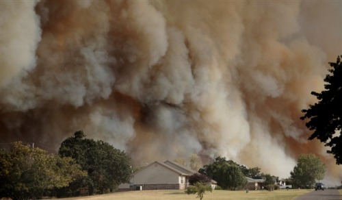 Dozens of homes destroyed in Oklahoma wildfires (Photo: Sarah Phipps / AP) Updated at 5:55 p.m ET: At least 121 structures, many of them homes, have been destroyed by wildfires in Oklahoma, officials said Saturday as temperatures topped 100 degrees for a 19th straight day. New evacuations were under way Saturday as well: Included were the entire towns of Glencoe, population of around 600, and Mannford, population about 3,000, and surrounding areas. Thousands were on the move as a fire spread quickly in Creek County, 20 miles west of Tulsa, the Oklahoma Highway Patrol reported.   Read the complete story.