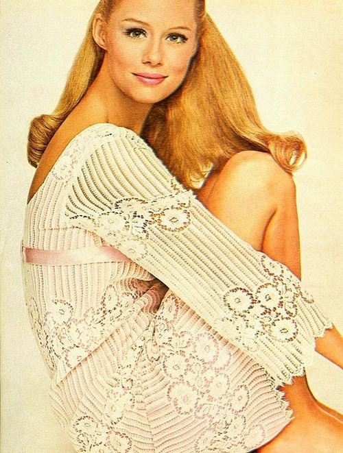 Lauren Hutton wearing a lace dress with pink satin ribbon for Mademoiselle, October 1966.