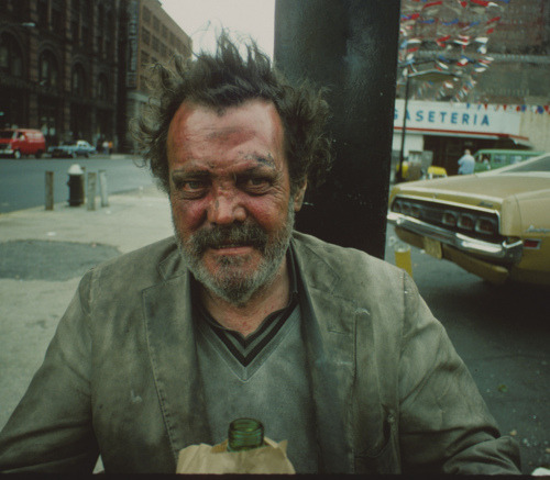 "By Steven Siegel, The Bowery and Houston Street circa 1980 from the set NY in the 80s - ""Poverty is not simply having no money — it is isolation, vulnerability, humiliation and mistrust. It is not being able to differentiate between employers and exploiters and abusers [j: I'd say it is not having the luxury of the choice to choose between them]. It is contempt for the simplistic illusion of meritocracy — the idea that what we get is what we work for. It is knowing that your mother, with her arthritic joints and her maddening insomnia and her post-traumatic stress disordered heart, goes to work until two in the morning waiting tables for less than minimum wage, or pushes a janitor's cart and cleans the shit-filled toilets of polished professionals. It is entering a room full of people and seeing not only individual people, but violent systems and stark divisions. It is the violence of untreated mental illness exacerbated by the fact that reality, from some vantage points, really does resemble a psychotic nightmare. It is the violence of abuse and assault which is ignored or minimized by police officers, social services, and courts of law. Poverty is conflict. And for poor kids lucky enough to have the chance to ""move up,"" it is the conflict between remaining oppressed or collaborating with the oppressor."" Megan Lee from this article about academia"