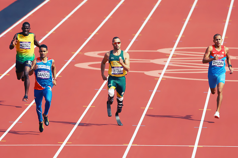 OLYMPICS DAY 8 South Africa's Osacr Pistorius made history tonight as the first amputee to compete in track at the Olympics in the 400M. He advances to the 400m semifinals. Photo by Paul Gilham