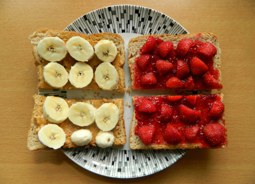 seedsnsmiles:  Brunch this morning - two slices of wholewheat toast, one with natural peanut butter and banana, the other with raspberry jam and fresh halved strawberries.