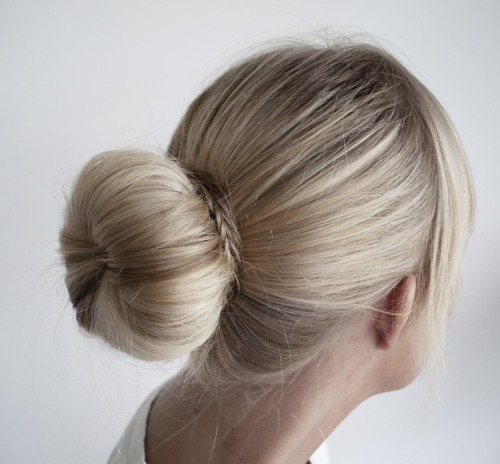 "DIY Big Bun Using a ""Bun Donut"" from Concreate here. Yes, everyone knows about the ""Bun Donut"" but I really like the fishtail braid she used to hide the pins. Tip: If you want to make your own ""Bun Donut"" there are lots of YouTube videos and tutorials like this one uses a sock here: wikihow.com/Make-a-Donut-Bun"