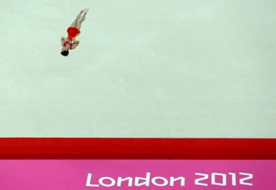 LONDON, ENGLAND - AUGUST 05: Zou Kai of China competes on the floor in the Artistic Gymnastics Men's Floor Exercise final on Day 9 of the London 2012 Olympic Games at North Greenwich Arena on August 5, 2012 in London, England.