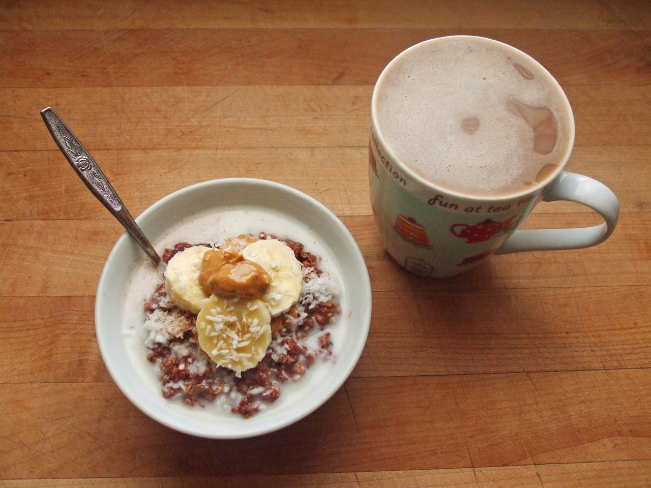chocolate oatmeal with coconut, banana, peanut butter, and coconut milk, coffee with coconut milk