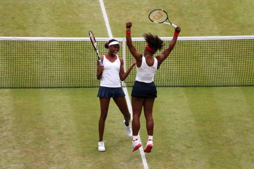 olympics:  Serena Williams and Venus Williams of the United States celebrate after defeating Andrea Hlavackova and Lucie Hradecka of Czech Republic in the Women's Doubles Tennis gold medal match. Photo by Clive Brunskill/Getty Images