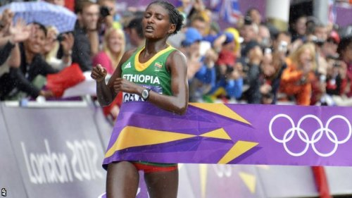 "homoislamicus:  ""This gold is a gift for all Ethiopians."" Tiki Gelana wins the Women's Marathon with a time of 2 hours, 23 minutes, 7 seconds, breaking the Olympic record. She is only the second Ethiopian to win the Olympic marathon. What's more, she slipped and fell in the middle of the race and bruised her elbow but she got up and continued on with the race, like the champ she is."