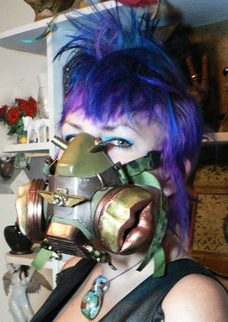 I bought the gas mask shell at some yard sale and customized it with paint, clay, ribbons, bullet casings, and other stuff.  The lips and tentacles are hand molded from polymer clay.  The left picture is me, and the right is my friend Whitney.
