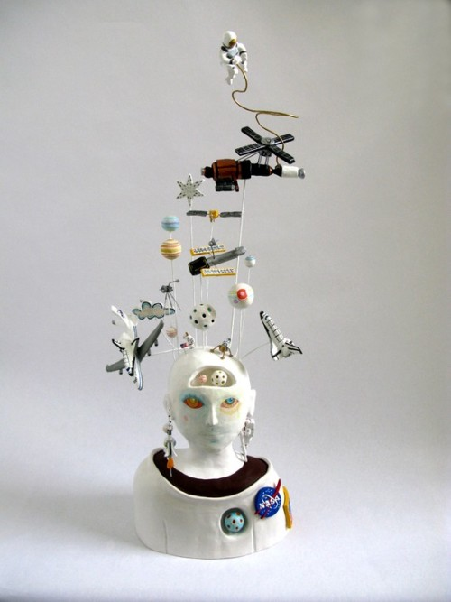 bookspaperscissors:  'The Astronaut', for the NASA Space Craft contest, Black Birds on a Wire, Shoes on a Wire, Hippo Factory, Ghost Factory, The Direction of Happiness, Cat in the Clouds, Mystery Tiger Question Mark, Pink Tiger Exclamation Point, Underwater Scene Loch Ness Monster and more ceramic sculptures by PearsonMaron