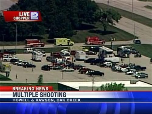 "thedailywhat:  Breaking News: Sikh Temple Shooting: At least four people are dead and many more are wounded in a shooting at a Sikh temple in Oak Creek, Wisconsin. Police have released little information regarding victims or the number of shooters, but scanner reports indicate at least 20 people are wounded while one of the suspects was ""put down."" Witnesses inside described as many as four gunmen, one of them being a white male with a heavy build and wearing a sleeveless t-shirt. The first officer on the scene was shot multiple times, and was transported to a nearby hospital. He is expected to survive. [cnn]  This is our country, guys."