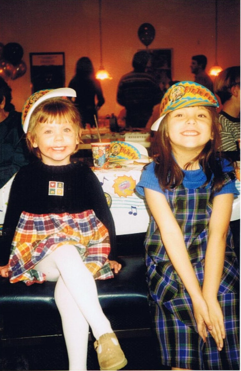 This is my sister and I when we were little assholes. I found this picture in a gaint box of old photos and I just loved it so much. Look at how precious we are.