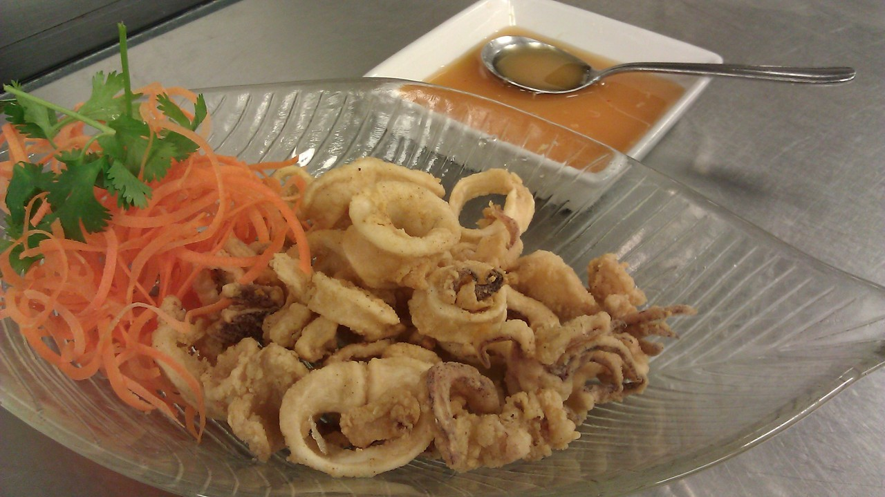 Golden Fried Calamari served with our own spicy lime sauce.