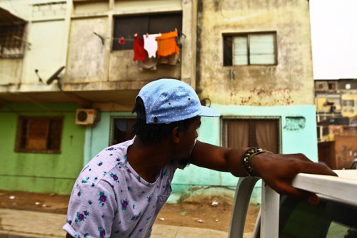 streetetiquette:  [Travel Etiquette : Luanda, Angola preview] Travis riding through the market in Luanda. I had to post at least one image. Back from Africa!