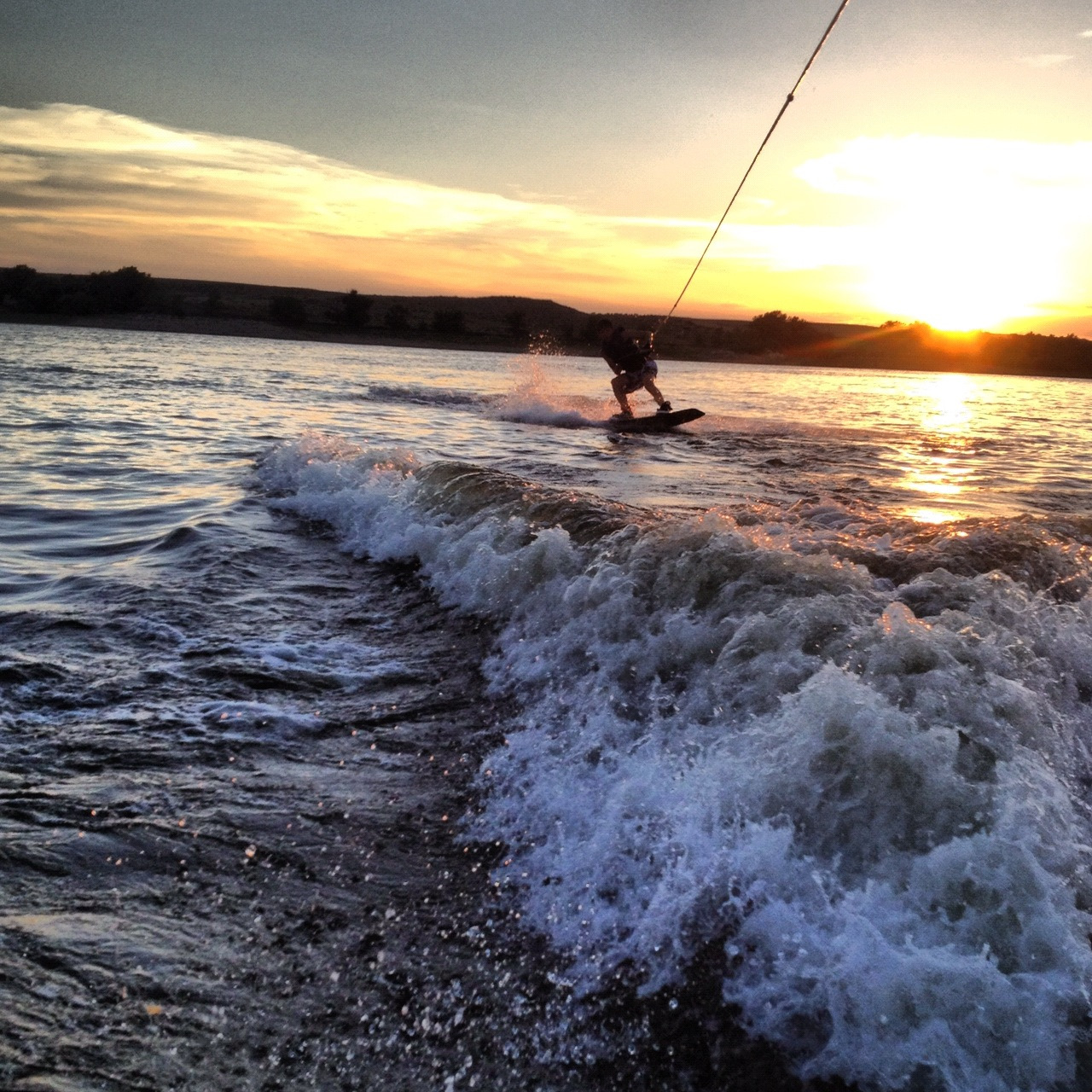 belowthiscloudlesssky:  Me wakeboarding in Colorado..