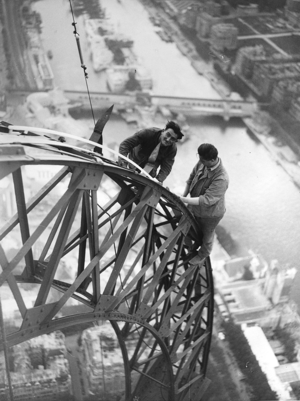 Electricians working on the Eiffel Tower, Paris, France, 1937