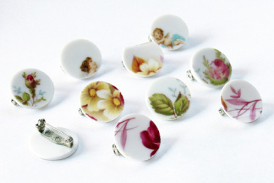 These ceramic badges and pendants are made out of old, neglected porcelain plates (mainly single pieces) found [at] flea markets.  Selected areas are carefully cut out, sanded and glued to a pin. This way old ceramic plates are turned into fashion accessories.  (via mischer'traxler ceramic badges)