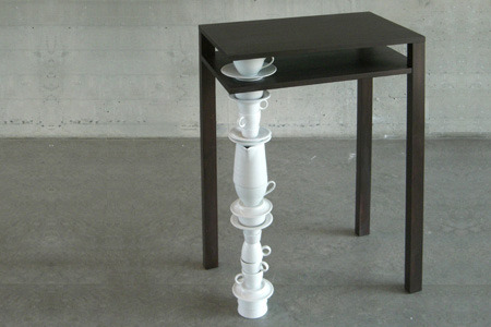 mischer'traxler ben:  Ben is a side table out of wood with one leg out of old stacked and fixed porcelain.  Preferable overproduced items, b-series of porcelain or pieces from flea markets are used to form the leg of the table.