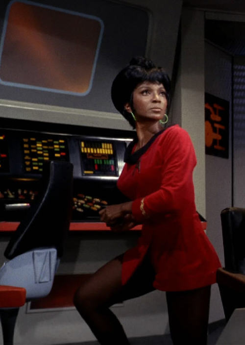 "snowsgreen:  Nichelle Nichols - Uhura of Star Trek  This picture reminds me of a story. During the first year of the series, Nichols was tempted to leave the show, as she wanted to pursue a Broadway career; however, a conversation with Dr. Martin Luther King, Jr., changed her mind. She has said that King personally encouraged her to stay on the show, telling her that he was a big fan of the series. He said she ""could not give up"" because she was playing a vital role model for black children and young women across the country, as well as for other children who would see African Americans appearing as equals."