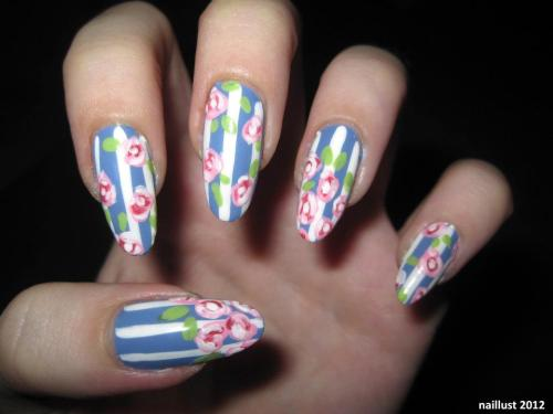 30 Day Nail Art ChallengeDay 14 - Floral Surprisingly, this was my first attempt at roses. I learned a lot (mostly why i've never before painted roses) but I'll learn more in the future.  Products used:OPI Ridge FillerChina Glaze Secret PeriwinkleFinger Paints Paper MâchéOPI Pink FridayOrly Pink ChocolateOrly Green AppleSeche Vite