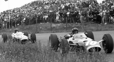 what we miss … the uncut grassGraham Hill in the BRM P261 leading Dan Gurney in the Brabham-Climax BT11 at the 1965 Dutch Grand Prix at Zandvoort