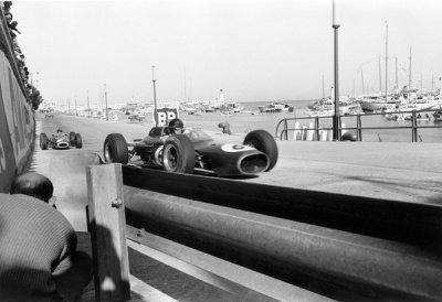 what we miss … racing line photographersDan Gurney (Brabham-Climax BT7) leading Graham Hill (BRM P261) through Bureau de tabac, 1964 Monaco Grand Prix