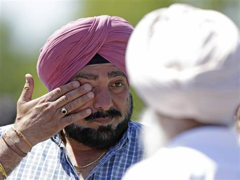 "nbcnews:  Gunman opens fire at Sikh temple in Wisconsin; 7 dead (Photo: Jeffrey Phelps / AP) Updated at 5:37 p.m. ET:  A gunman opened fire Sunday morning at a Sikh temple outside of Milwaukee, killing six people and wounding at least three others, including a police officer, before being shot to death, authorities said.  The identity of the shooter was not released and his motive was unknown. ""We're treating this as a domestic terrorist-type incident,"" Oak Creek Police Chief John Edwards said at a late afternoon press conference. He did not elaborate.  Read the complete story."