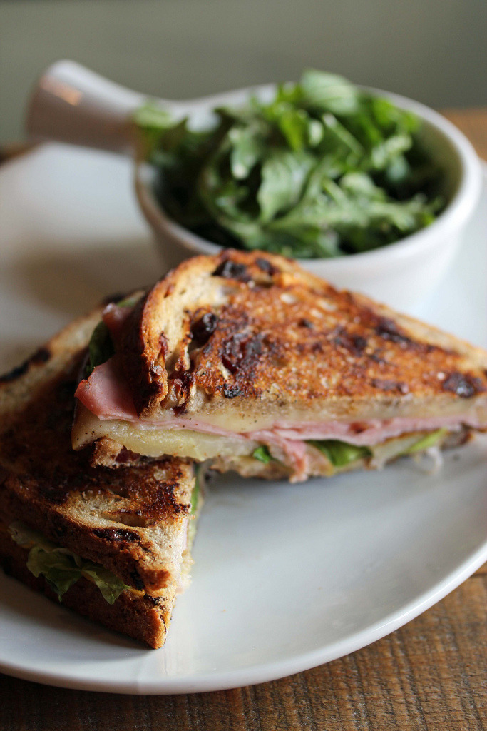 Smoked Ham Grilled Cheese at AlobarRoasted pear, cheddar, Dijon, cranberry walnut bread, mixed greens.(found on: flickr)