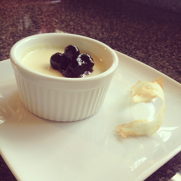 Panna cotta with a blueberry sauce and tuile cookie. (Taken with Instagram)