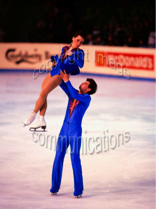 Lloyd Eisler (here with Katarina Matousek) demonstrates that yes, skating costumes CAN go low enough to be Perez' Nightwing actually!
