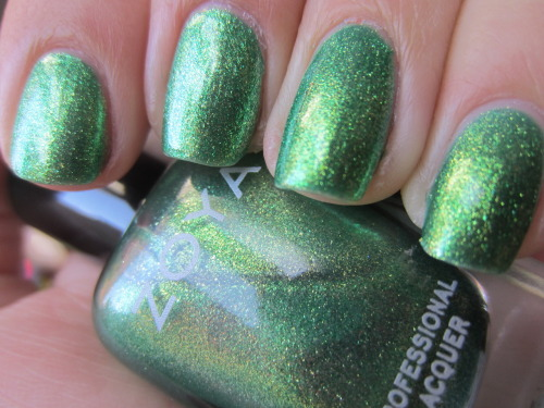 "zoya ""apple"" this is one of my first glass fleck polishes and look how pretty and bright this is!!! a granny apple green with a gold shimmer that is almost like a duochrome.  it shimmers to bright green to medium toned green to gold.  love!"
