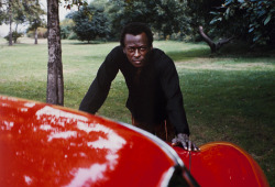 """That photo of Miles Davis and his red Ferrari (275 GTB) was taken on New York's West Side Highway in 1969. We had just shot some portraits in his apartment near Central Park. He said he wanted to go to Gleason's Gym to work out. He was am amateur boxer, as you probably know. Anyhow, we're driving along and I said, 'Miles, pull over. Let's do some shots of you and this totally cool car.' He said 'yes', we did, and then proceeded to the gym where he threatened to knock me out."" –Baron Wolman"